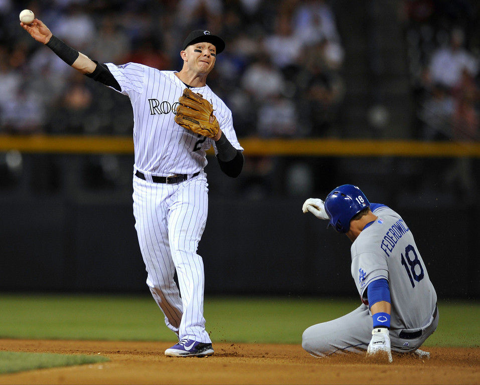. Colorado Rockies shortstop Troy Tulowitzki (2) throws to first to complete the double play after forcing out Los Angeles Dodgers\' Tim Federowicz (18) at second during the fourth inning of a baseball game, Tuesday, Sept. 3, 2013, in Denver. Ricky Nolasco was out at first. (AP Photo/Jack Dempsey)