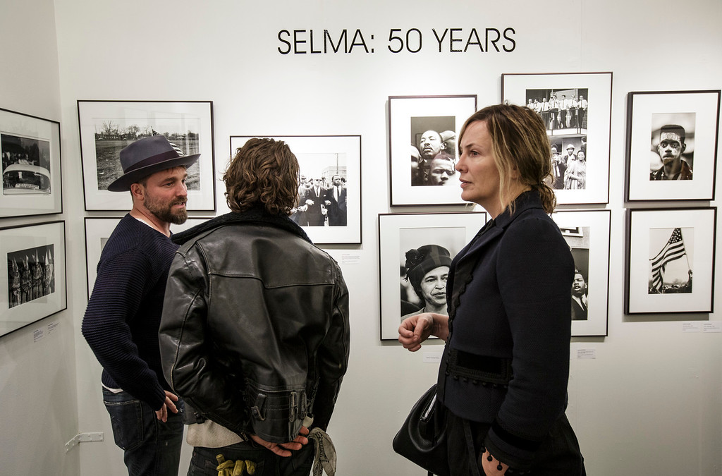 . Visitors view photos at the photo la opening party held at The REEF/LA Mart in Los Angeles, CA. January 15, 2015.  Photo by David Sprague/Special to the Daily News