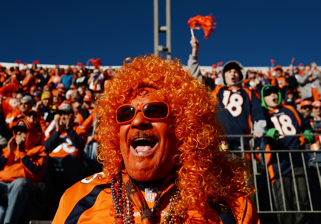 . Denver Broncos fan Dave Moler cheers on his team at Sports Authority Field at Mile High, January, 17, 2016. The Denver Broncos will take on Pittsburgh Steelers during AFC division playoff game. (Photo by RJ Sangosti/The Denver Post)