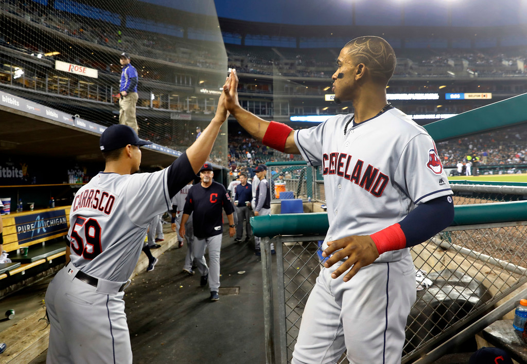. Cleveland Indians pitcher Carlos Carrasco (59) and Francisco Lindor high five after the sixth inning of a baseball game against the Detroit Tigers in Detroit, Monday, May 14, 2018. (AP Photo/Paul Sancya)