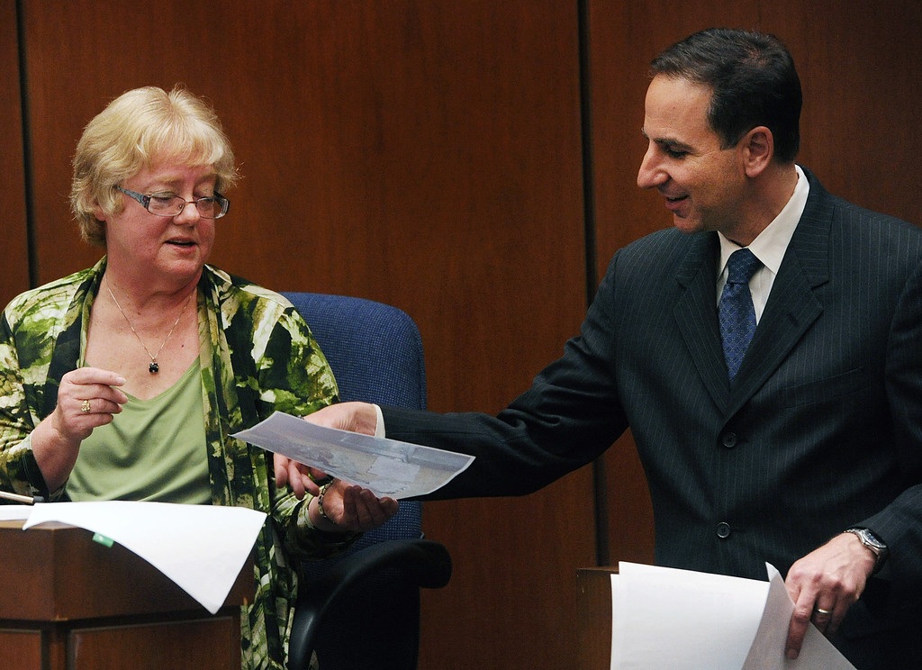 . Judith Daye, consultant, and anthropolists for coroners office  looking at evidence photos from when she investigated the unearthed bones found in the backyard of the San Marino home on Lorraine Road.  Murder trial for Christian Karl Gerhartsreiter, at Clara Shortridge Foltz Criminal Justice Center in Los Angeles Monday, March 25, 2013.  A prosecutor told jurors Monday he will prove a cold-case murder allegation against the German immigrant who spent years moving through U.S. society under a series of aliases, most notoriously posing as a member of the fabled Rockefeller family. He has pleaded not guilty to the killing of John Sohus, 27, who disappeared with his wife, Linda, in 1985 while Gerhartsreiter, using an alias was a guest cottage tenant at the home of Sohus\' mother, where the couple lived.(Photo by Walter Mancini, SGVN)