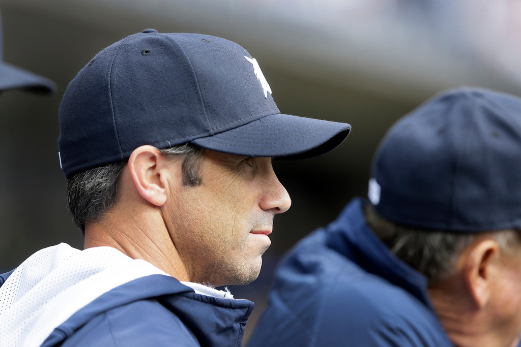 . Detroit Tigers manager Brad Ausmus is seen in the dugout during the eighth inning of an opening day baseball game against the Minnesota Twins in Detroit, Monday, April 6, 2015. (AP Photo/Carlos Osorio)