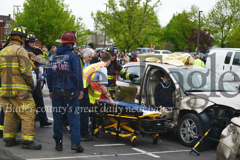 4 Column Photo. Photo by Caleb Harshberger. Mars mock crash 4; local; 0430; cut: Students at Mars High School learned a vivid lesson about the dangers of drunken driving at a mock crash reenactment Tuesday morning.