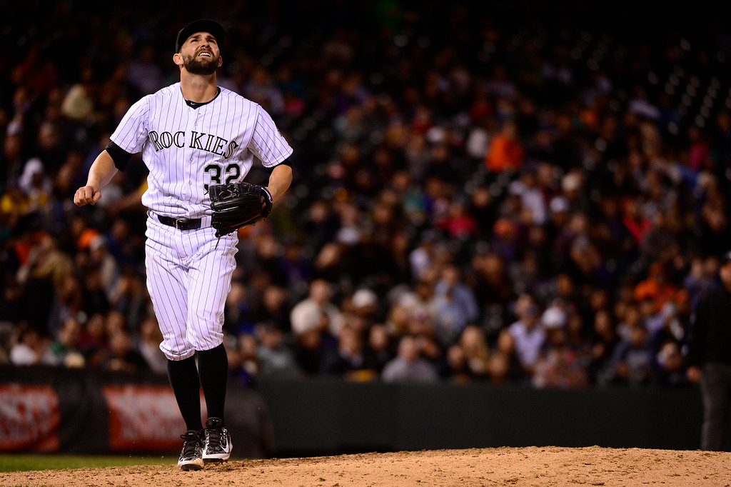 . DENVER, CO - APRIL 12: Colorado Rockies starting pitcher Tyler Chatwood (32) watches a shot to deep center during the fifth inning at Coors Field on April 12, 2016 in Denver, Colorado. San Francisco Giants defeated the Colorado Rockies 7-2. (Photo by Brent Lewis/The Denver Post)