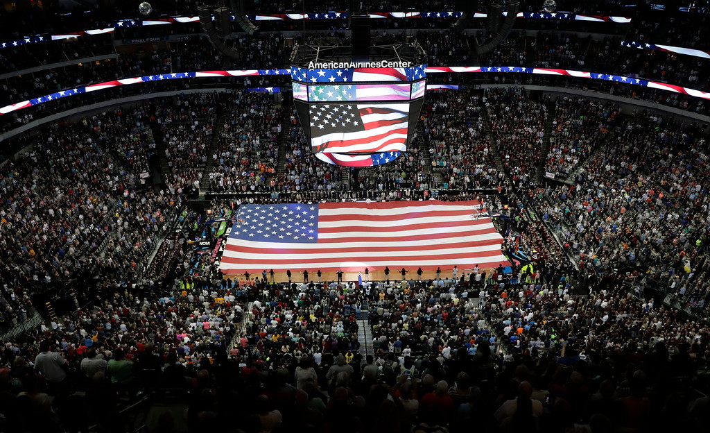 . A large U.S. flag is stretched over the court prior to the finals of the women\'s Final Four NCAA college basketball tournament, Sunday, April 2, 2017, in Dallas. (AP Photo/Eric Gay)