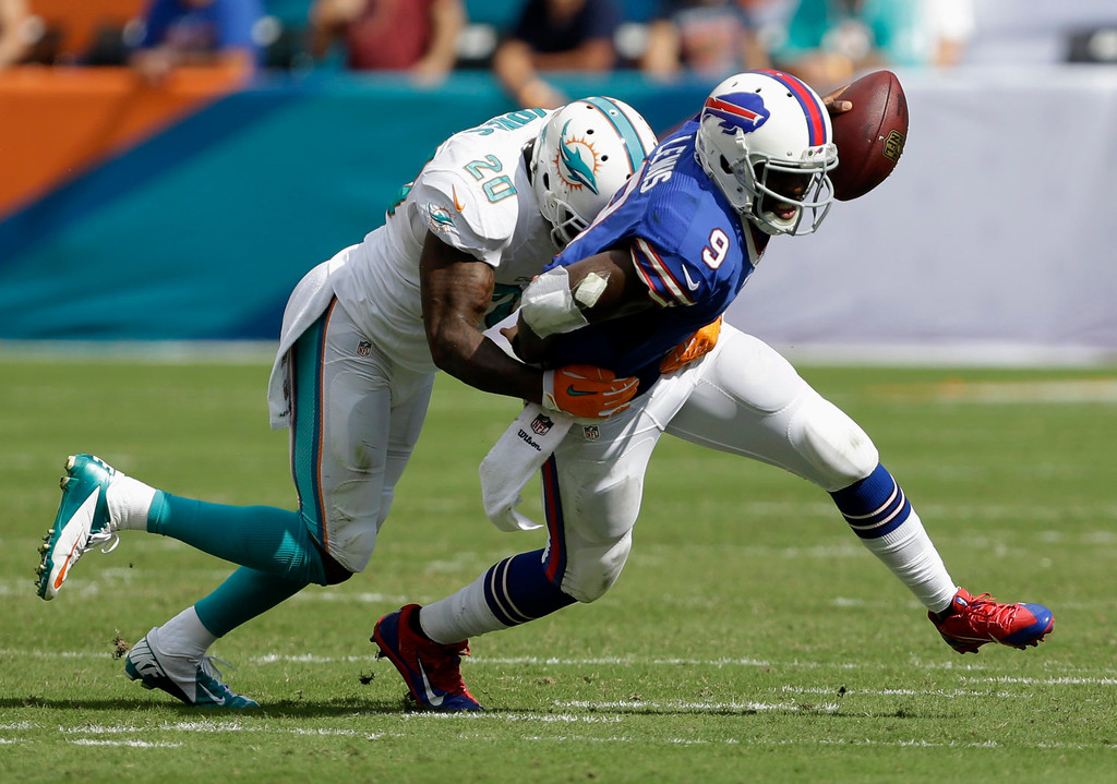 . Buffalo Bills quarterback Thad Lewis (9) is sacked by Miami Dolphins free safety Reshad Jones (20) during the second half of an NFL football game, Sunday, Oct. 20, 2013, in Miami Gardens, Fla. (AP Photo/Wilfredo Lee)
