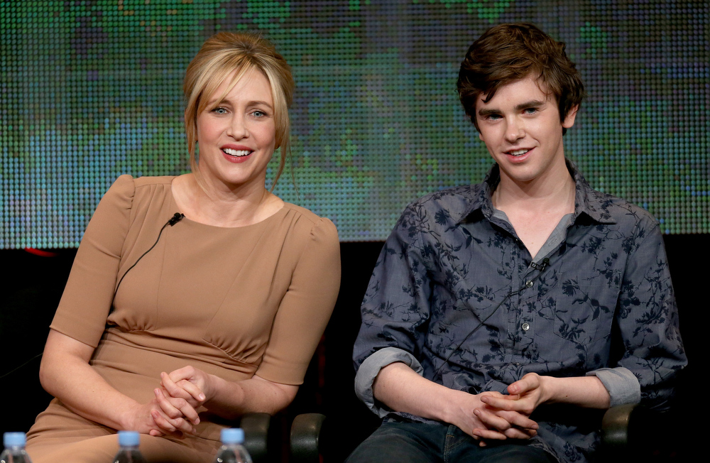 "Description of . Actors Vera Farmiga (L) and Freddie Highmore speak onstage during the ""Bates Motel\"" panel discussion at the A&E Network portion of the 2013 Winter TCA Tourduring 2013 Winter TCA Tour - Day 1 at Langham Hotel on January 4, 2013 in Pasadena, California.  (Photo by Frederick M. Brown/Getty Images)"
