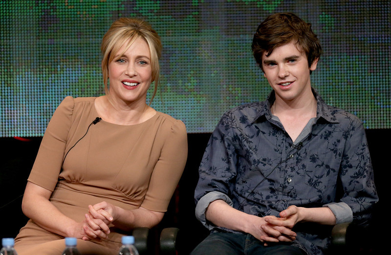 ". Actors Vera Farmiga (L) and Freddie Highmore speak onstage during the ""Bates Motel\"" panel discussion at the A&E Network portion of the 2013 Winter TCA Tourduring 2013 Winter TCA Tour - Day 1 at Langham Hotel on January 4, 2013 in Pasadena, California.  (Photo by Frederick M. Brown/Getty Images)"