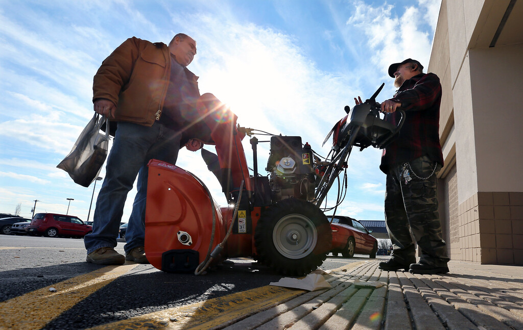 . Richard Warner, of Newtown, Pa., right, and an unidentified man discuss the pros and cons of various snowblowers outside a Lowe\'s home improvement warehouse Thursday, Jan. 21, 2016, in Langhorne, Pa. The northern mid-Atlantic region, including Baltimore, Washington and Philadelphia, is preparing for a weekend snowstorm that is now forecast to reach blizzard conditions. (AP Photo/Mel Evans)