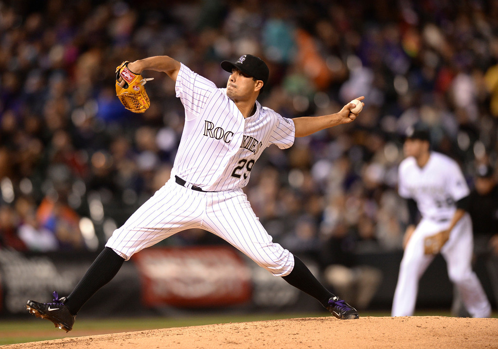 . DENVER, CO - MAY 15: Colorado starter Jorge De La Rosa delivered to the plate in the seventh inning. He gave up only one run in seven innings. The Colorado Rockies hosted the San Diego Padres at Coors Field  Friday night, May 16, 2014. (Photo by Karl Gehring/The Denver Post)