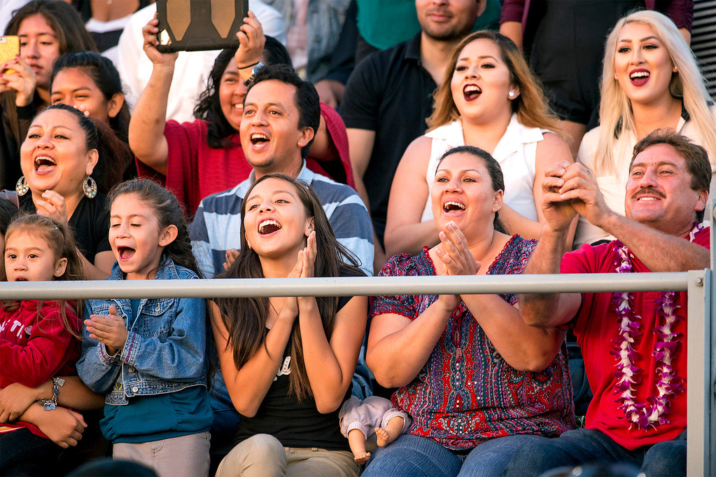 . Families cheer for their grads during the Northview High commencement ceremony at Covina District Field June 11, 2014.   (Staff photo by Leo Jarzomb/San Gabriel Valley Tribune)