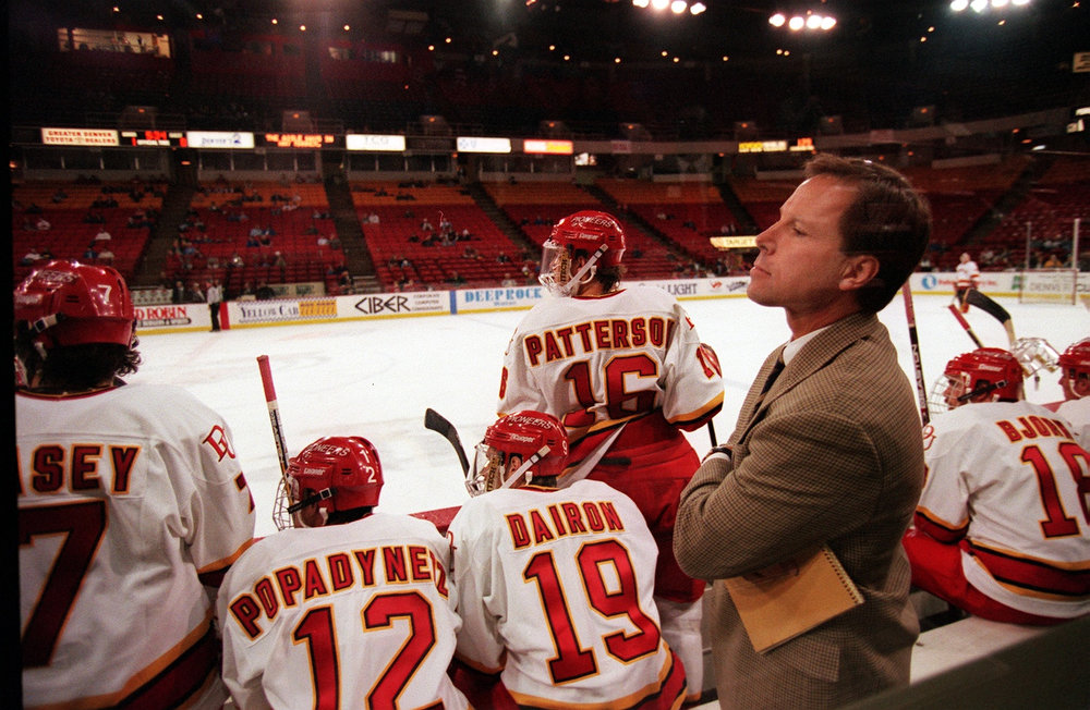 . DU hockey coach George Gwozdecky watches from the bench  as his team plays Michigan Tech at McNichols.  Photo by Kent Meireis/The Denver Post
