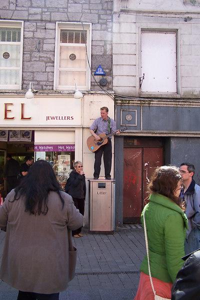 Galway street singer on litter bin