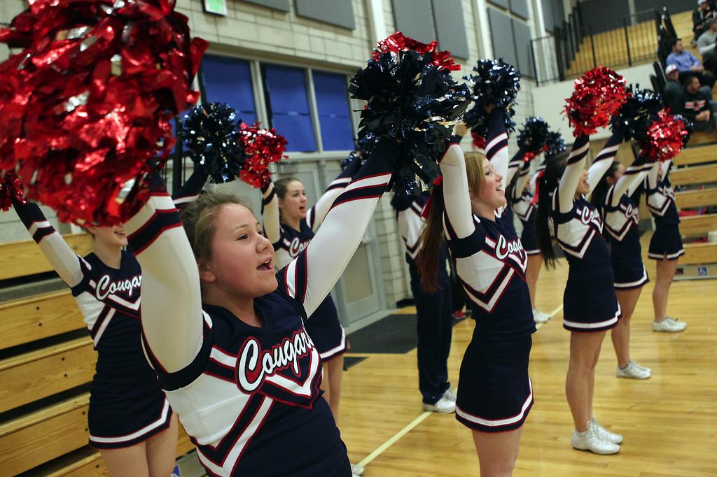 . Campolindo High School cheerleaders cheer on their team in the first half of their basketball game against Dublin in Dublin, Calif., on Friday, Jan. 18, 2013. (Anda Chu/Staff)