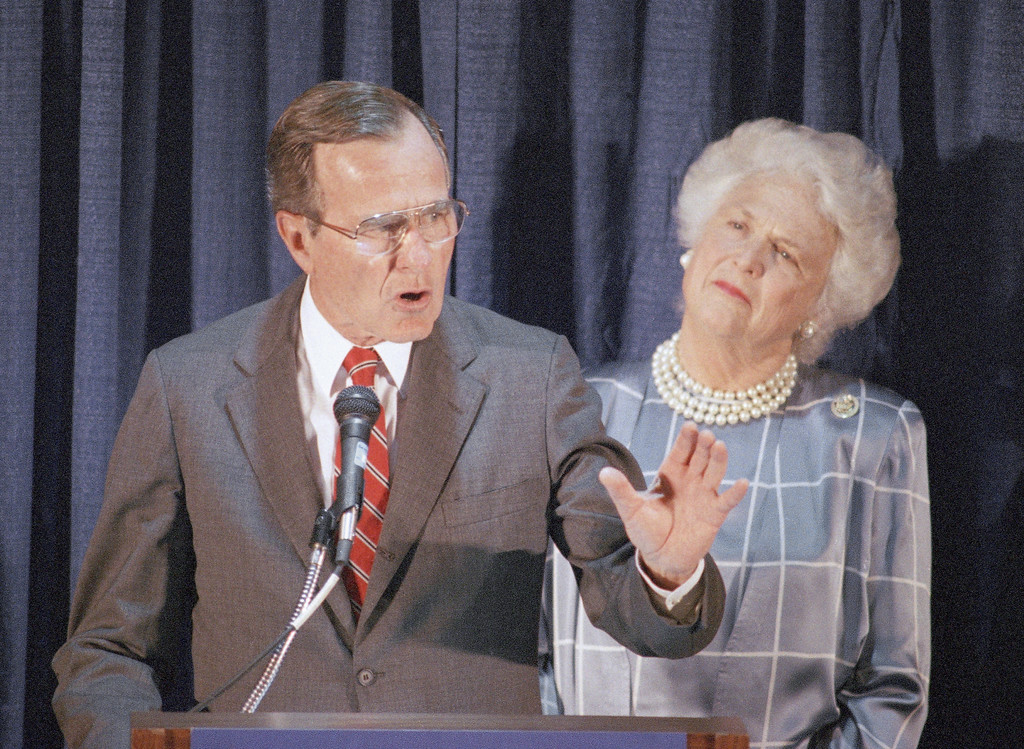 . Republican presidential candidate George H.W. Bush, with wife Barbara looking on, speaks to a gathering at a GOP Victory \'88 reception held at the Ontario Hilton Hotel June 6, 1988 in Ontario CA. Bush took Democratic candidate Michael Dukakis to task for some of his recent statements. (AP Photo/Lennox McLendon)