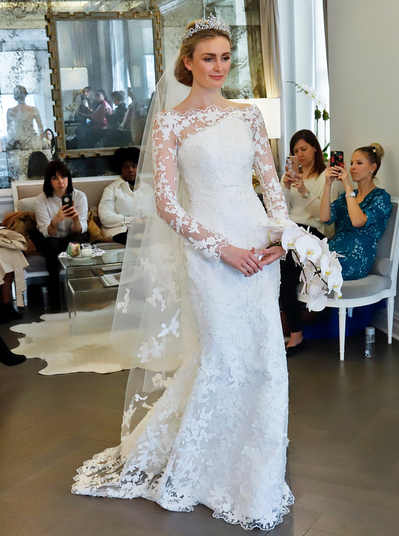 . Bridal fashion from the Romona Keveza collection is modeled during Bridal Fashion Week, Thursday April 12, 2018 in New York. (AP Photo/Bebeto Matthews)