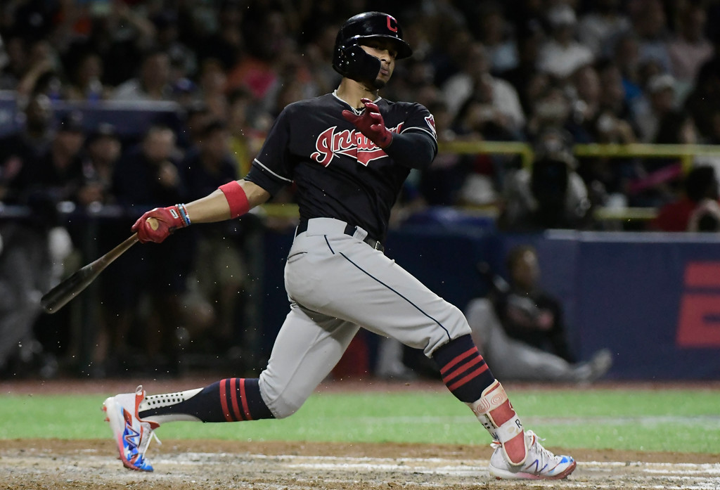 . Cleveland Indians\' infielder Francisco Lindor hits in the eighth inning during the final match of a two-game Mayor League Series against the Minnesota Twins at the Hiram Bithorn Stadium in San Juan, Puerto Rico, Wednesday, April 18, 2018. (AP Photo/Carlos Giusti)