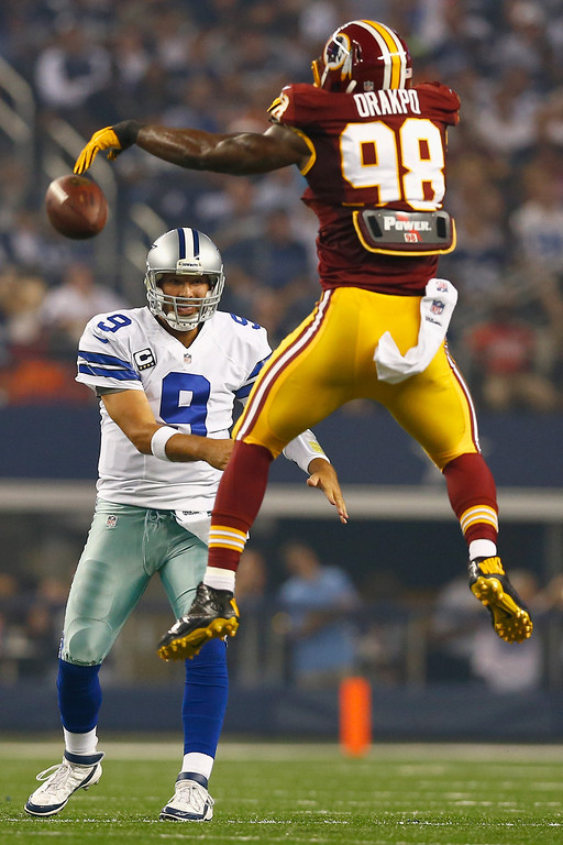. Brian Orakpo #98 of the Washington Redskins tips a pass thrown by  Tony Romo #9 of the Dallas Cowboys in the second quarter on October 13, 2013 in Arlington, Texas.  (Photo by Tom Pennington/Getty Images)