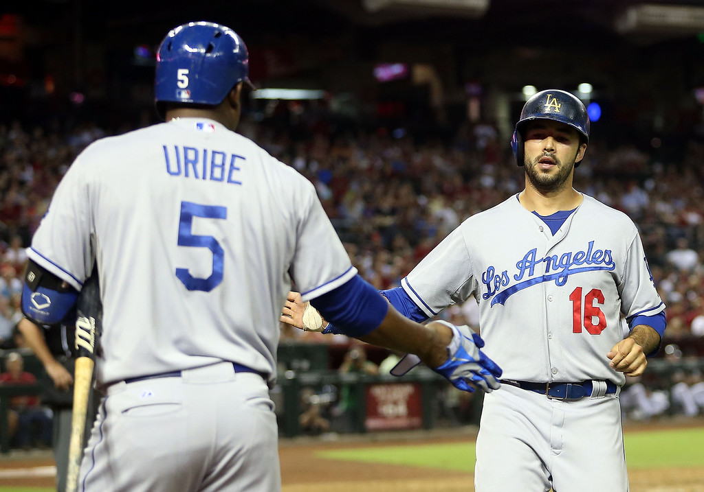 . PHOENIX, AZ - JULY 08:  Andre Ethier #16 of the Los Angeles Dodgers high fives Juan Uribe #5 after scoring against the Arizona Diamondbacks during the seventh inning of the MLB game at Chase Field on July 8, 2013 in Phoenix, Arizona.  (Photo by Christian Petersen/Getty Images)