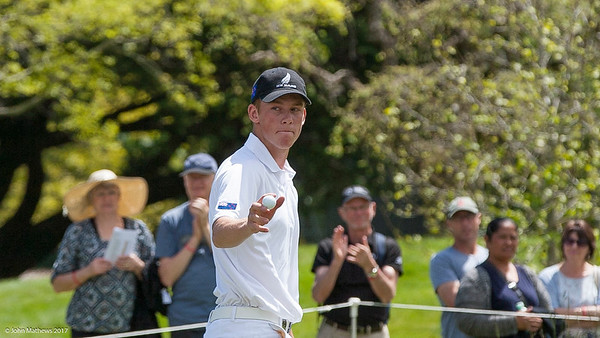 Daniel Hillier acknowledging fans' applause on the 18th green on the 3rd day of competition  in the Asia-Pacific Amateur Championship tournament 2017 held at Royal Wellington Golf Club, in Heretaunga, Upper Hutt, New Zealand from 26 - 29 October 2017. Copyright John Mathews 2017.   www.megasportmedia.co.nz