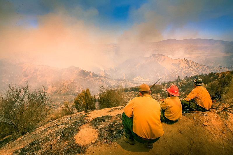 Firefighters watch the Zaca Fire burning in Los Padres backcountry.