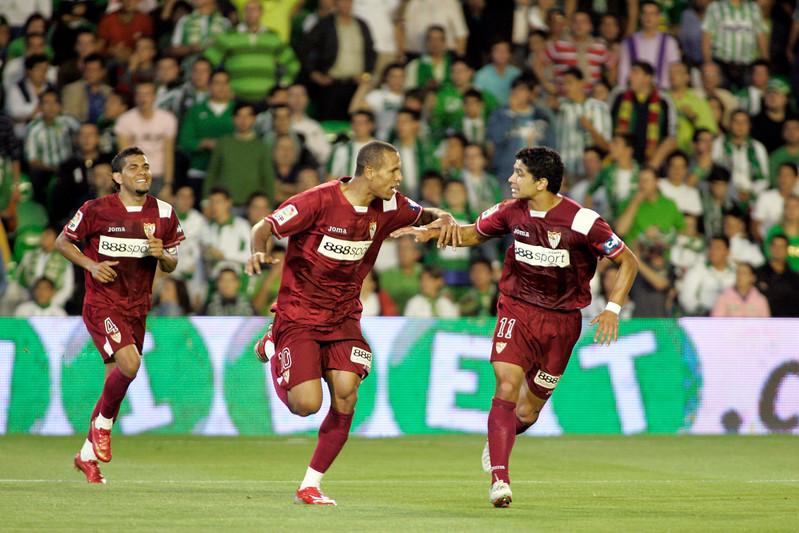 Daniel Alves, Luis Fabiano and Renato celebrating a goal. Local derby between Real Betis and Sevilla FC, Ruiz de Lopera stadium, Seville, Spain, 11 May 2008.