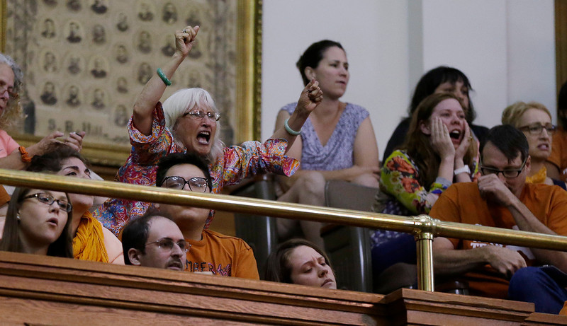 . Members of the gallery respond as Sen. Wendy Davis, D-Fort Worth, is called for a third and final violation in rules to end her filibuster attempt to kill an abortion bill, Tuesday, June 25, 2013, in Austin, Texas. The bill would ban abortion after 20 weeks of pregnancy and force many clinics that perform the procedure to upgrade their facilities and be classified as ambulatory surgical centers.  (AP Photo/Eric Gay)