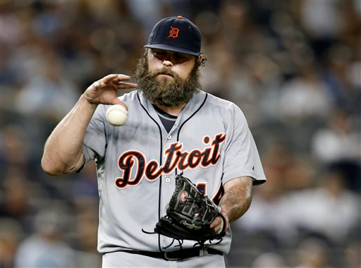 . Detroit Tigers relief pitcher Joba Chamberlain reacts after hitting New York Yankees\' Derek Jeter with a pitch in the 10th inning of a baseball game at Yankee Stadium in New York, Tuesday, Aug. 5, 2014. (AP Photo/Kathy Willens)