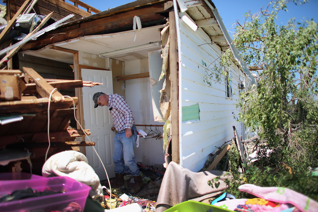 . EL RENO, OK - JUNE 01:  Larry Corr looks for items to salvage from a home destroyed when a tornado hit on June 1, 2013 in El Reno, Oklahoma. The tornado ripped through the area last night killing at least nine people, injuring many others and destroying homes and buildings.  (Photo by Joe Raedle/Getty Images)