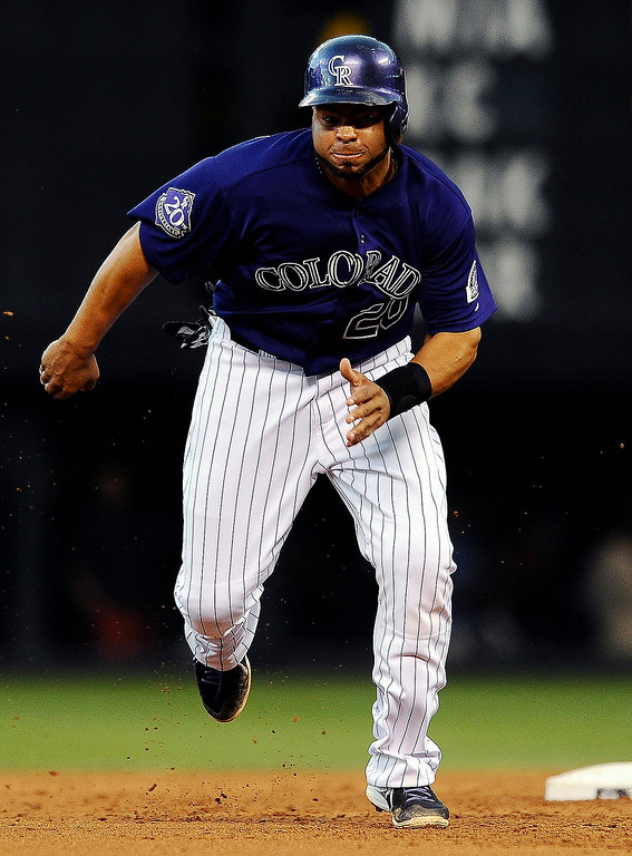 . Colorado Rockies Wilin Rosario runs to third base on a single by Rockies Nolan Arenado in the first inning of a baseball game against the San Diego Padres on Monday, Aug. 12, 2013 in Denver. (AP Photo/Chris Schneider)