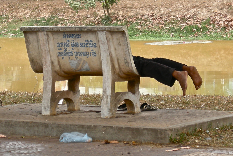 Man sleeping on bench, Siem Reap