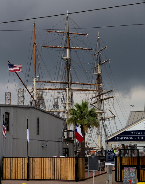Back at Galveston Harbor.  The Elissa's masts against a foreboding sky.