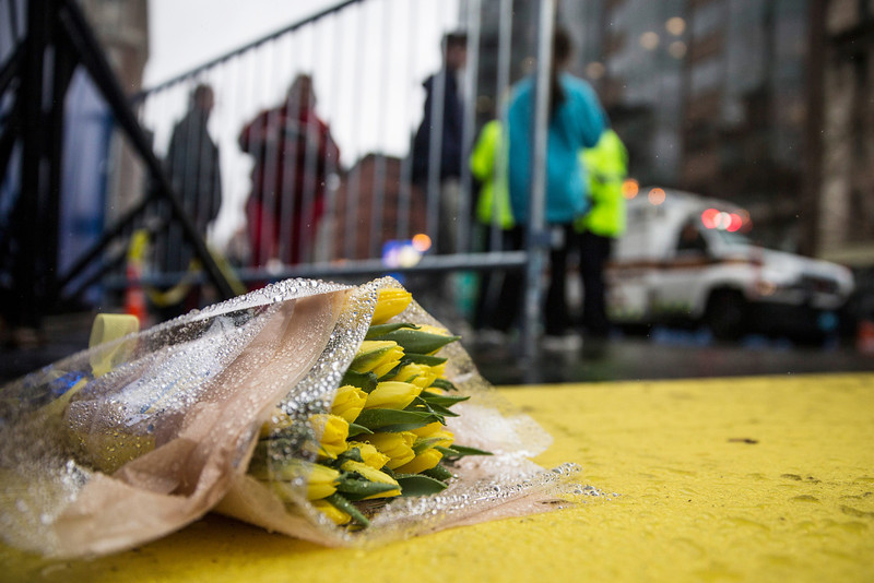 . Flowers lie on the finish line of the Boston Marathon on the one year anniversary of the 2013 Boston Marathon Bombing, on April 15, 2014 in Boston, Massachusetts. Last year, two pressure cooker bombs killed three and injured an estimated 264 others during the Boston marathon, on April 15, 2013.  (Photo by Andrew Burton/Getty Images)