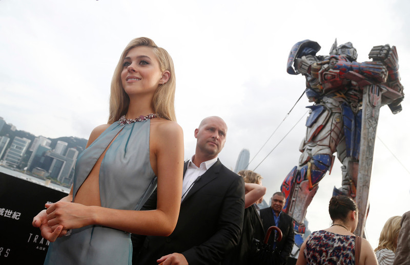 """. American actress Nicola Peltz poses on the red carpet as she arrives for the world premiere of the movie \""""Transformers 4: Age of Extinction\"""" in Hong Kong Thursday, June 19, 2014. The latest installment in the blockbuster series of \""""Transformers\"""" films is making its world premier not in the usual entertainment hubs of Los Angeles or New York but in the wealthy Chinese metropolis of Hong Kong, the latest sign of Hollywood\'s increasing focus on China\'s booming film market. (AP Photo/Kin Cheung)"""