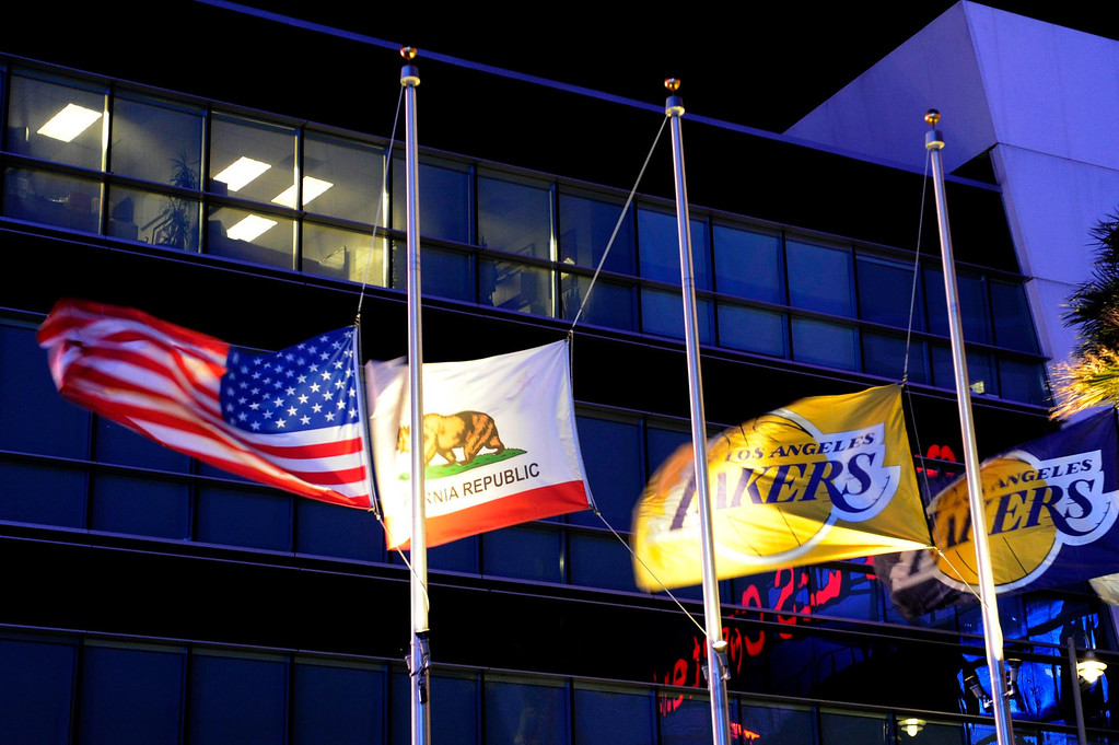 . Flags outside the Staples Center are flying at half mast. The Lakers posted large banners around LA Live and Staples Center with a photo of Jerry Buss and plenty of room for fans to write their best wishes. Los Angeles, CA 2/20/2013(John McCoy/Staff Photographer)