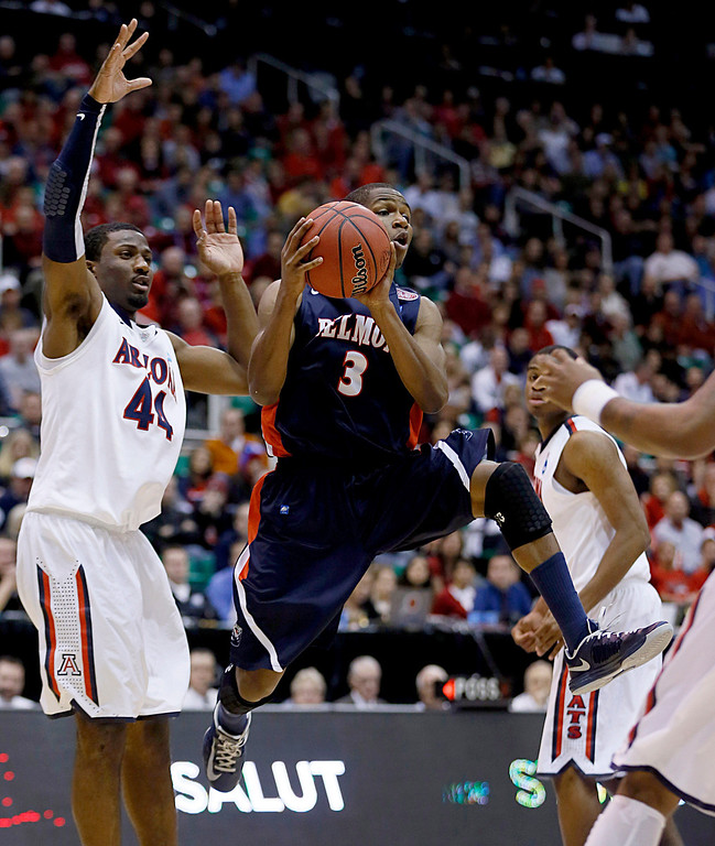 . Belmont\'s  Kerron Johnson, right, looks to pass as Arizona\'s Solomon Hill defends in the second half during a second-round game in the NCAA college basketball tournament in Salt Lake City, Thursday, March 21, 2013. Arizona won 81-64. (AP Photo/George Frey)