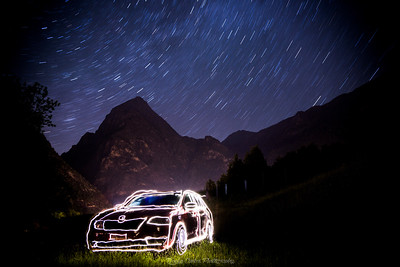 Car Light Painting under Sky full of Stars