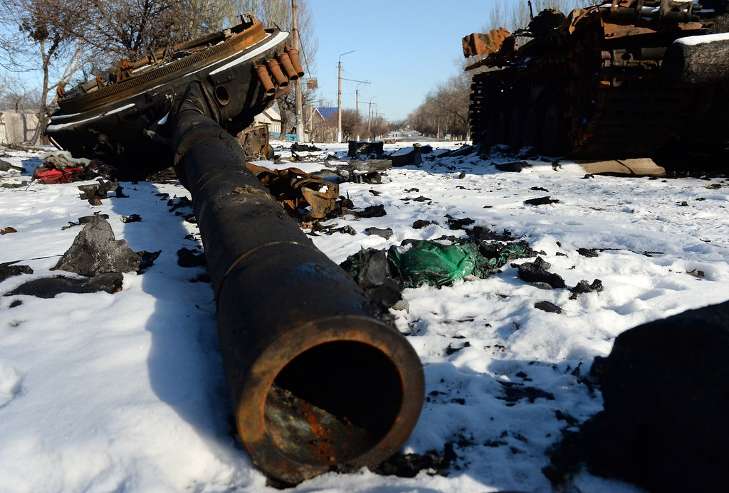 """. The wreckage of an Ukrainian army tank sits in Uglegorsk, 6 kms southwest of Debaltseve, on February 18, 2015. Ukrainian troops pulled out of the besieged flashpoint eastern town Debaltseve after it was stormed by pro-Russian rebels in what the EU said was a \""""clear violation\"""" of an internationally-backed truce. The retreat from Debaltseve -- a strategic railway hub sandwiched between the main rebel-held cities of Donetsk and Lugansk -- was a serious defeat for Ukrainian President Petro Poroshenko, who came to office vowing to crush the separatist uprising. VASILY MAXIMOV/AFP/Getty Images"""