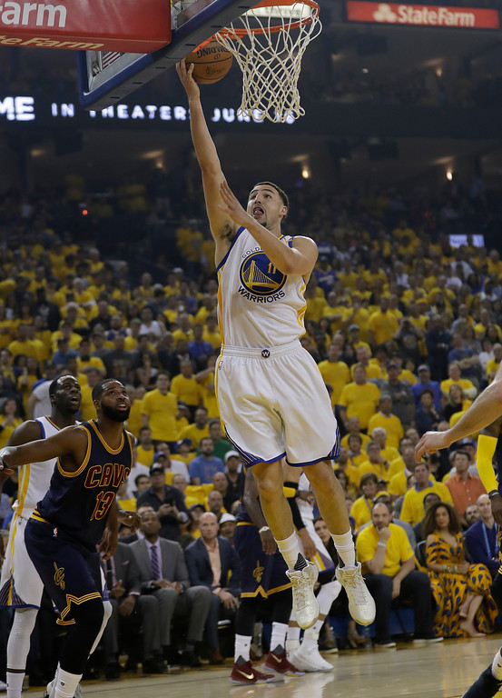 . Golden State Warriors guard Klay Thompson (11) shoots against the Cleveland Cavaliers during the first half of Game 1 of basketball\'s NBA Finals in Oakland, Calif., Thursday, June 1, 2017. (AP Photo/Marcio Jose Sanchez)
