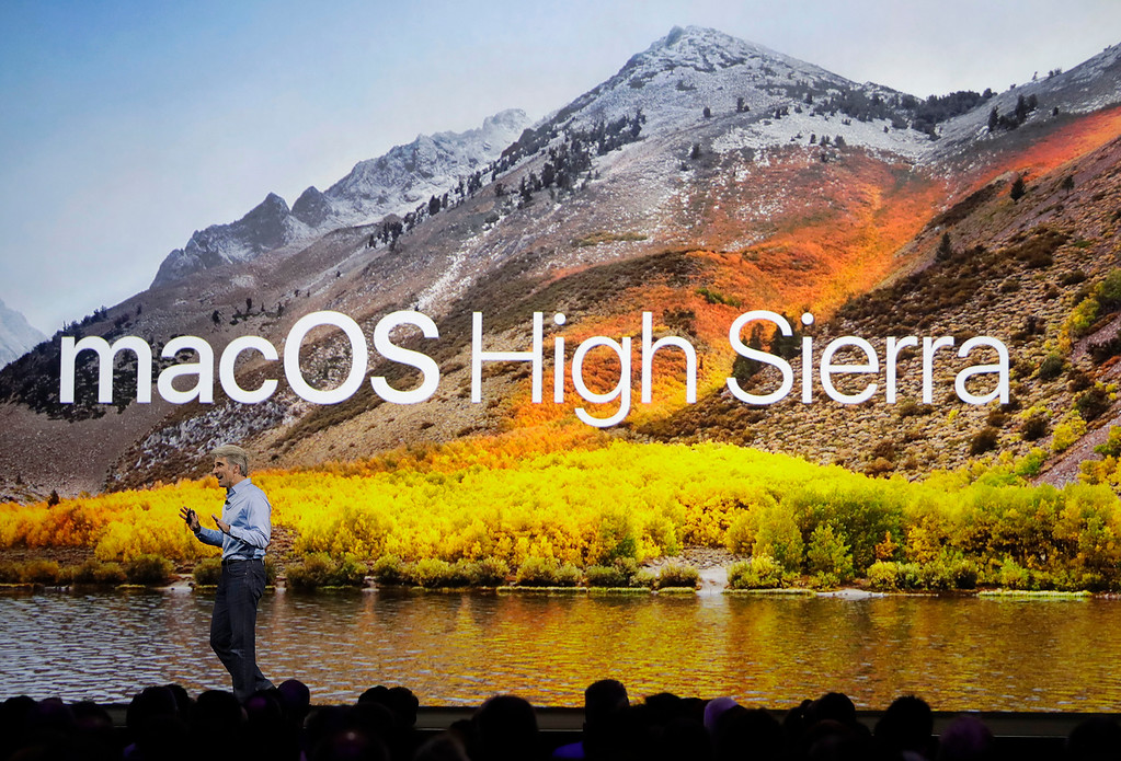 . Craig Federighi, Apple\'s senior vice president of software engineering, speaks about High Sierra operating software during an announcement of new products at the Apple Worldwide Developers Conference in San Jose, Calif., Monday, June 5, 2017. (AP Photo/Marcio Jose Sanchez)