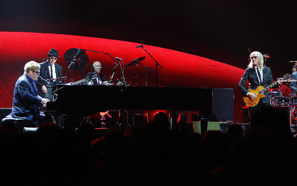 . Elton John and his band at Joe Louis Arena on Friday night. Photo by Ken Settle
