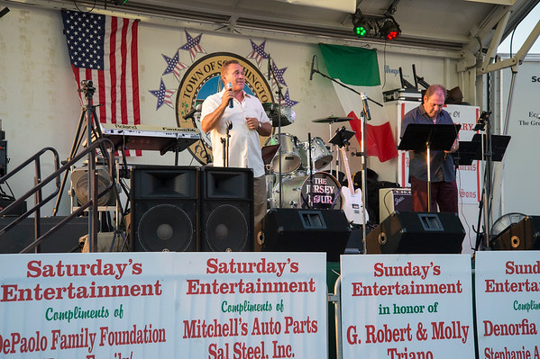 07/26/19 Wesley Bunnell | Staff Singer Teo Riciardella, L, performs songs in Italian and English on the first night of the Italian Festival in Southington on Friday night.