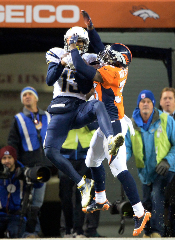 . San Diego Chargers wide receiver Keenan Allen (13) scores a touchdown in the second quarter with Denver Broncos cornerback Kayvon Webster (36) trying to block.  The Denver Broncos vs. the San Diego Chargers at Sports Authority Field at Mile High in Denver on December 12, 2013. (Photo by Hyoung Chang/The Denver Post)