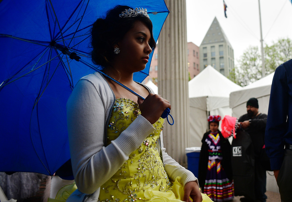 . Ashley Estrada, 14, waits for the start of the Quinceanera Fashion Show during the 29th Annual Cinco De Mayo Celebration at Civic Center Park in downtown Denver, Colorado, Saturday, May 7, 2016. Festivities were hampered by afternoon showers and some hail on Saturday, however festivities will continue on Sunday. (Brenden Neville/Special to the Denver Post)