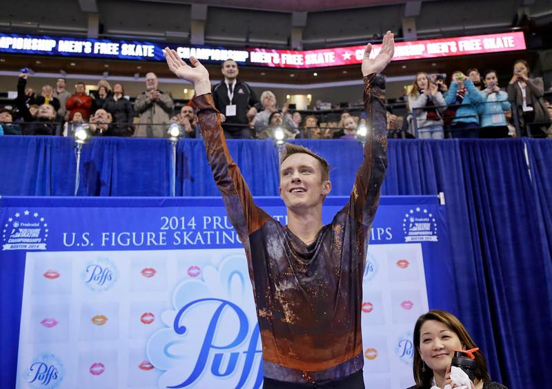 . Jeremy Abbott celebrates after learning his score for the men\'s free skate at the U.S. Figure Skating Championships Sunday, Jan. 12, 2014 in Boston. (AP Photo/Steven Senne)