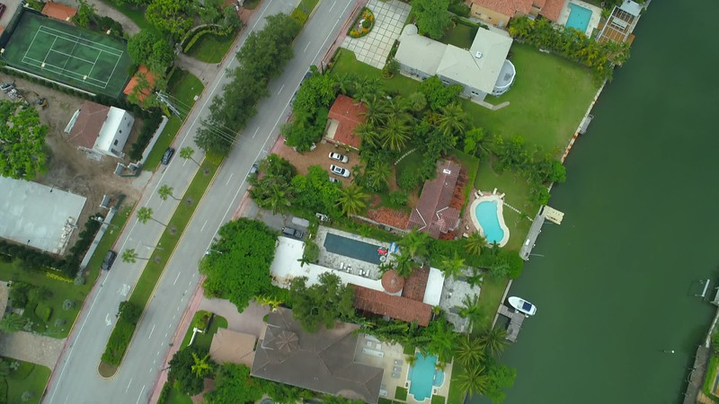 Drone flying over an upscale neighborhood in Miami Beach