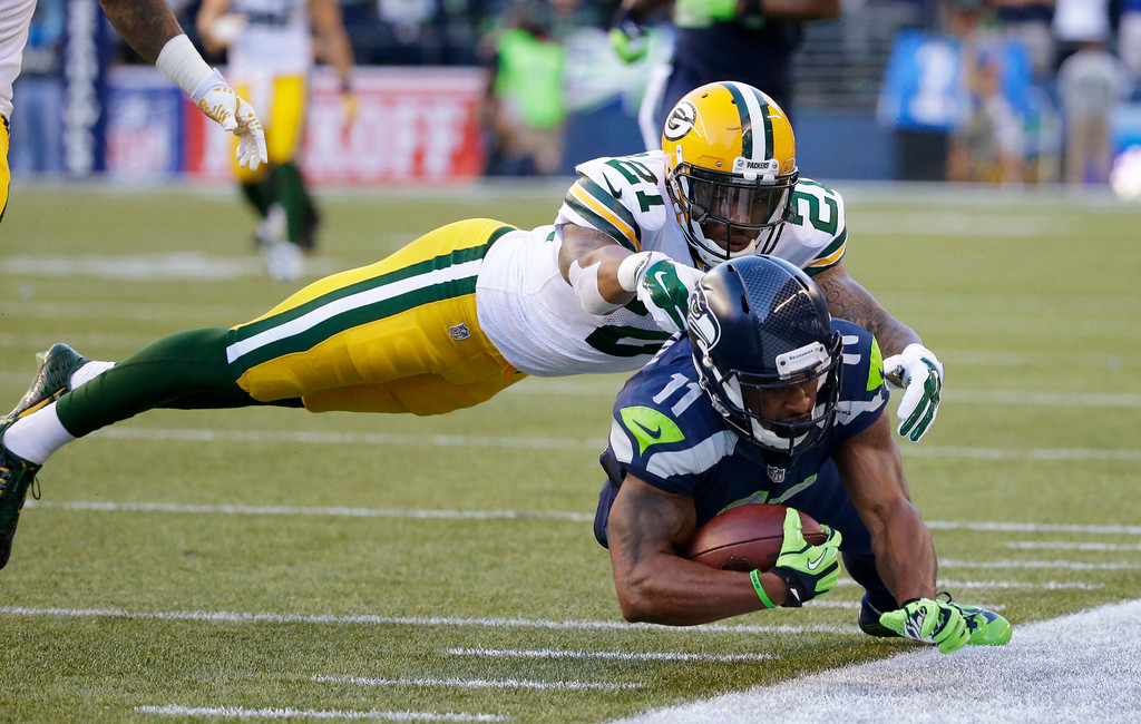 . Green Bay Packers free safety Ha Ha Clinton-Dix (21) tackles Seattle Seahawks wide receiver Percy Harvin (11) after a pass reception during the first half of an NFL football game, Thursday, Sept. 4, 2014, in Seattle. (AP Photo/Elaine Thompson)