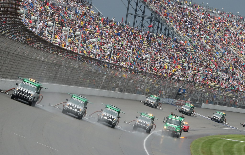. Air Titans dry the track during the NASCAR Sprint Cup series auto race at Michigan International Speedway, Sunday, June 14, 2015, in Brooklyn, Mich. (AP Photo/Bob Brodbeck)
