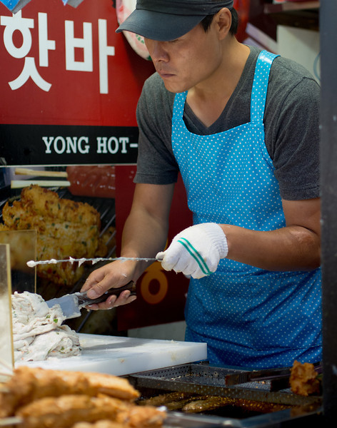 Street vendor making deep fried fish cake. Seto says it is soft and nice but rather greasy.