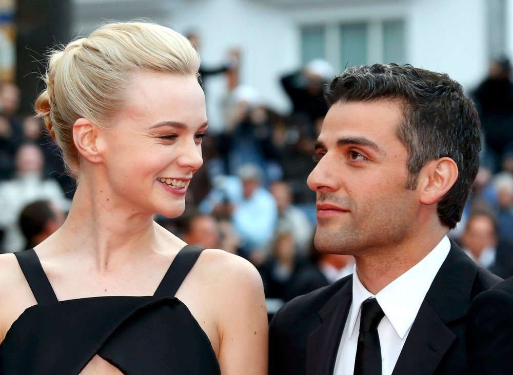 ". Cast members Carey Mulligan (L) and Oscar Isaac pose on the red carpet as they arrive for the screening of the film ""Inside Llewyn Davis\"" in competition during the 66th Cannes Film Festival in Cannes May 19, 2013.                      REUTERS/Jean-Paul Pelissier"